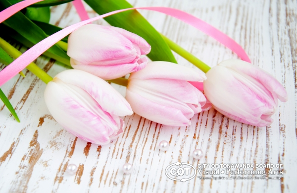 bouquet of pink tulips with pearls on a table